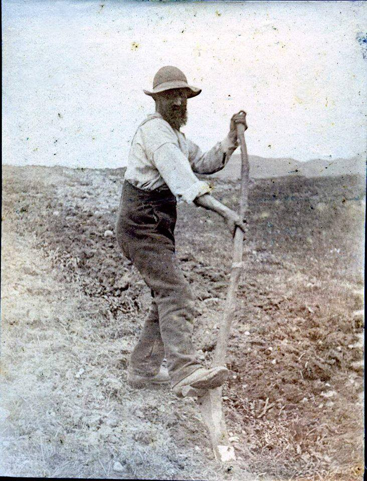 old black and white photo of a man using a cas crom