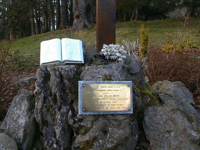 The plaque at the foot of the Cross