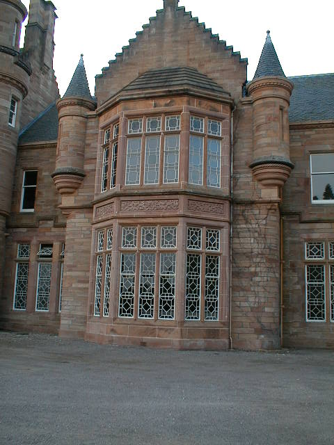 An ornate window at the front of the castle.