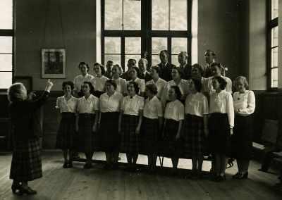 Miss Ethel Bassin rehearsing the Choir