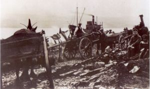 A photograph shows the unloading of coal at Findon pier.