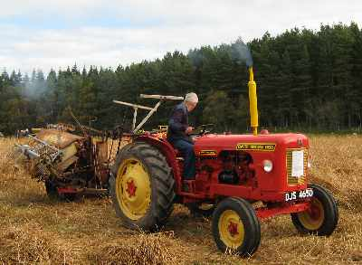 Traditional binder and modern tractor - photo 1