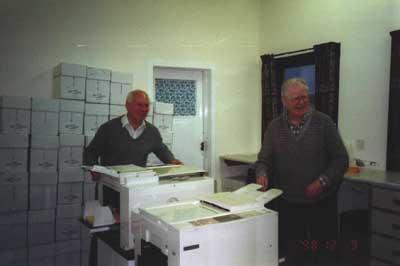 Tending the duplicating machine