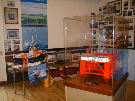Models of an oil rig and a lifeboat.