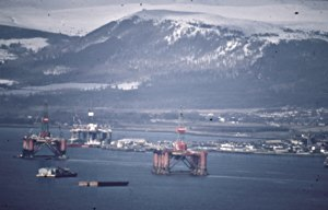 Invergordon, plus rigs, and Fyrish hill in the background.