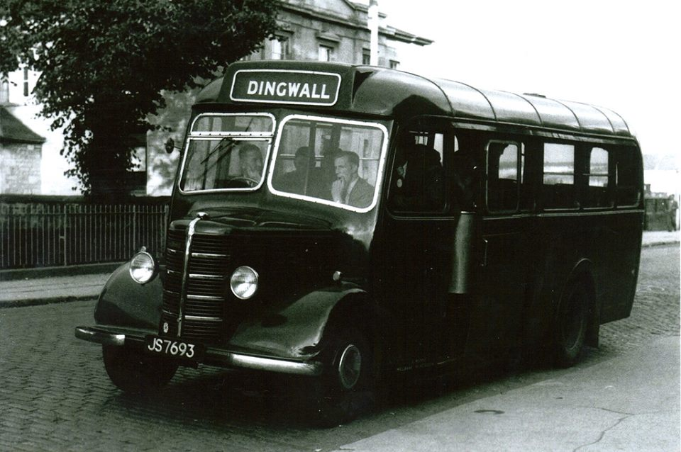 Archie Macrae's bus, JS7693, parked outside Royal Bank in Dingwall.  Note cobblestone road.