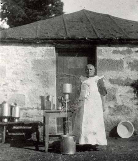 Mrs Isabella Maclean beside the first milk separator to be introduced to Ross-shire