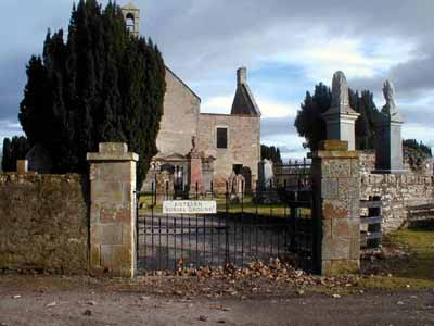 The entrance gate with Kiltearn Old Church in the background.