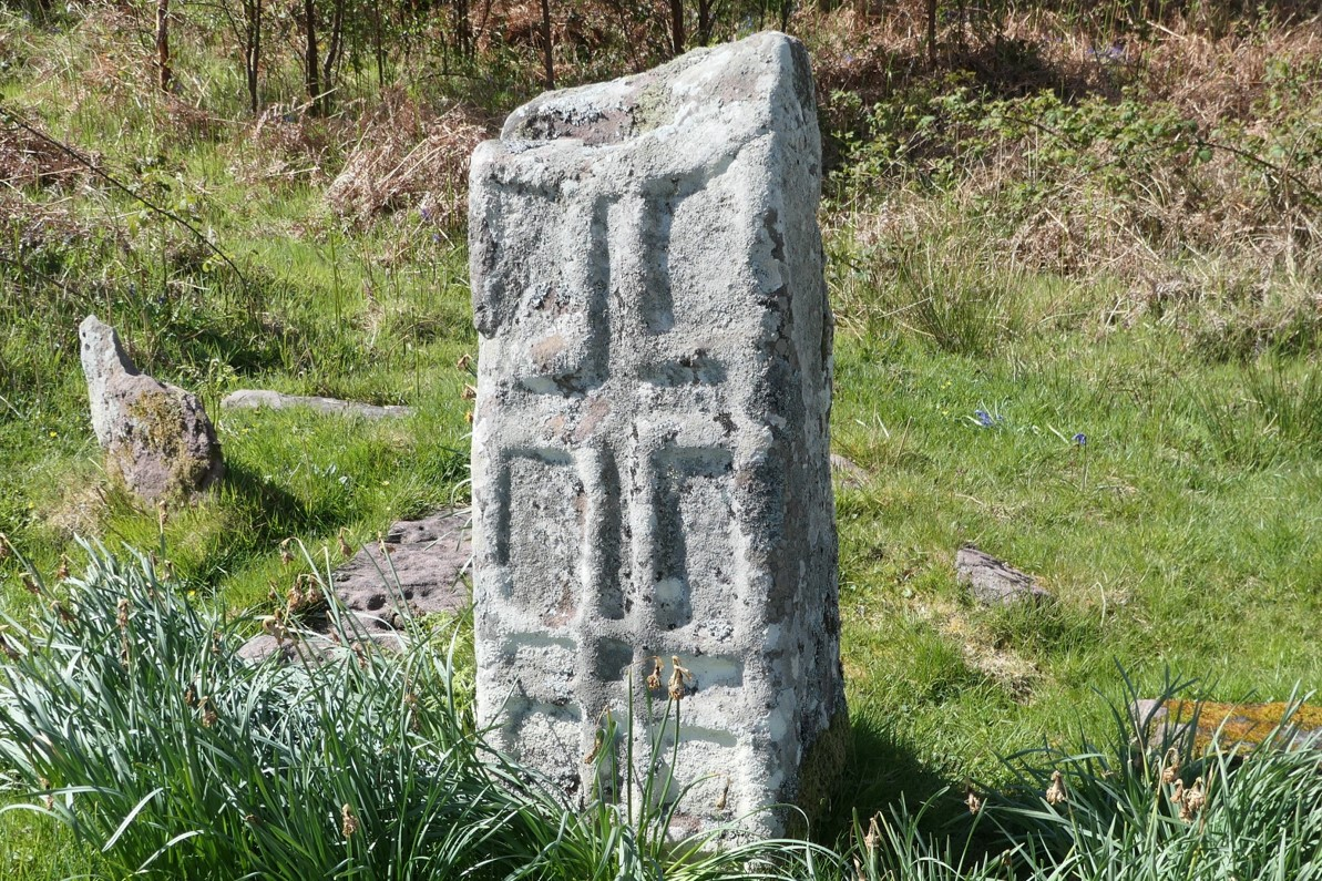 A cross slab within the burial ground