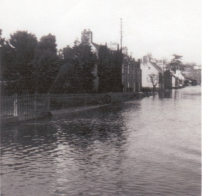 Flooding outside Ferintosh Church of Scotland (looking east towards river). - photo 5