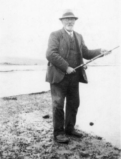 Photograph of Mr Murdo Fraser, JP, fishing on the Conon River