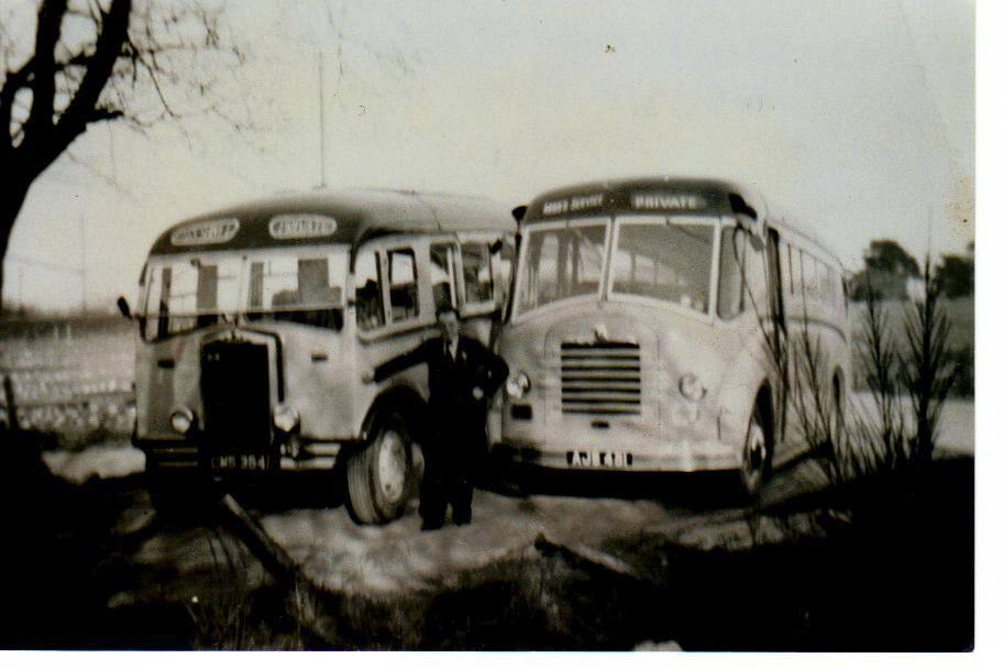 John Ross is seen standing between two of his vehicles