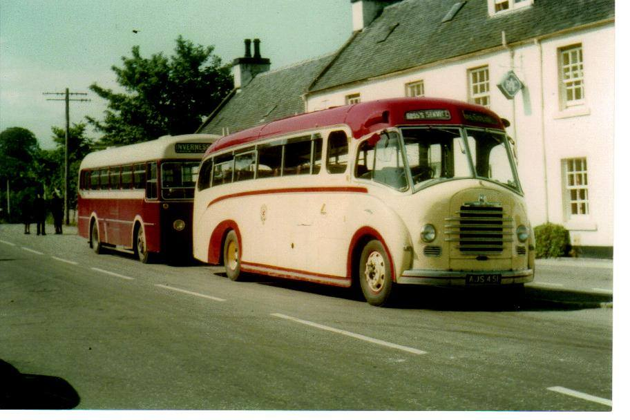 Johnnie Ross's red and cream bus parked outside Conon Hotel with a Highland Omnibuses vehicle behind.