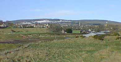 Site of Tain on the raised beach and at the foot of Tain Hill