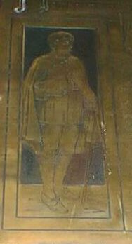 Detail from the 1914-1918 plaque - the figure of a scholar with a cloak, book, and stick
