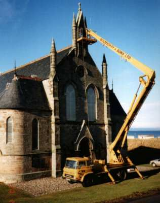 This picture shows the bell, following repair in 1994, being lifted back into position at a height of about 50' above ground.