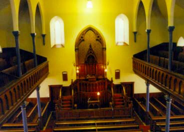 This picture shows the interior of the church, the woodwork being fine North American pine
