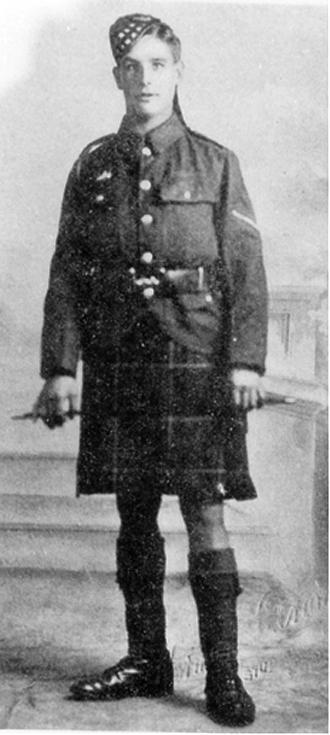 Sergeant John Meikle, standing wearing uniform