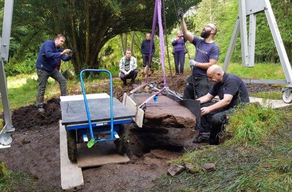 Carefully removing the stone. [Photo: NOSAS]