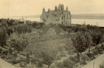 Rear view showing vegetable and fruit garden, with Cromarty Firth and Black Isle in background.