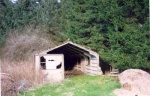 One of the remaining huts with stove.