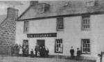 Photograph of the Post Office and Shop at Maryburgh owned by the Strachan family and taken after the year 1900. The photograph is taken from a postcard published by Macpherson Brothers of Beauly and Invergordon.