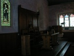Baptismal font, communion table and pulpit.